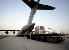 A pallet containing humanitarian relief supplies destined for Pakistan is prepared to be loaded into the cargo bay of a C-17 Globemaster III May 20 at an air base in Southwest Asia. USAF Released.