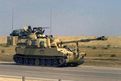 A US Army (USA) M109A6 155mm Paladin Self-propelled Howitzer travels along the highway on a march to the Euphrates River, in Iraq during Operation Iraqi Freedom.